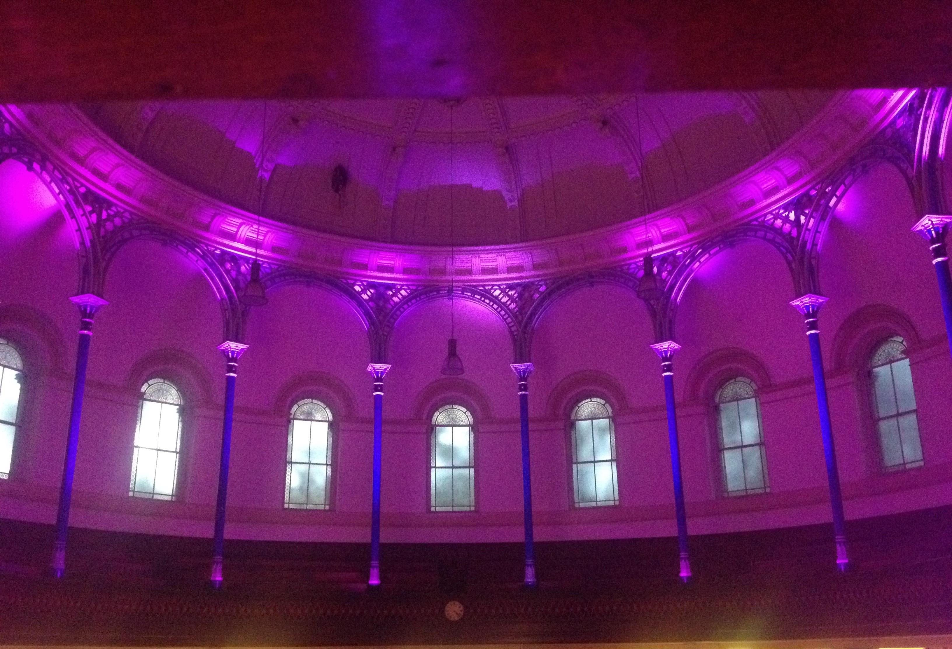 Uplighting pillars at a wedding.