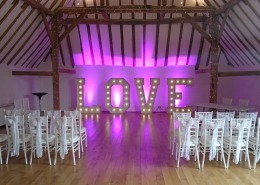 5ft LOVE with purple uplighters at skylarks gold club barn wedding