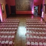 Wedding Ceremony uplighters and chivari chairs at cowdray house bucks hall