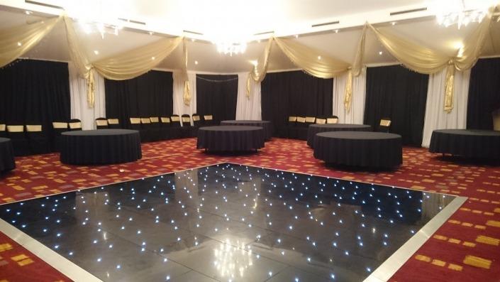 black led dancefloor and ceiling drapes at hilton avisford hotel