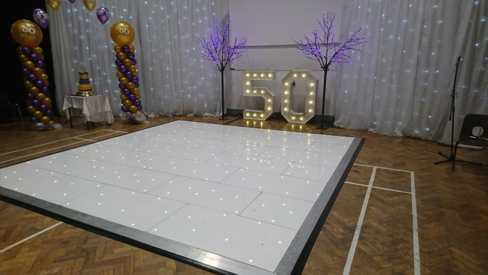 individual light up letters numbers 5 0 50 pink blossom tree and led backdrop white led dancefloor