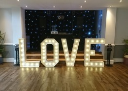 4ft LOVE and black starcloth at hilton avisford