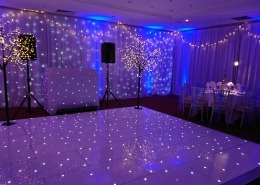 winter wonderland christmas parties at the portsmouth marriott white led dancefloor backdrop light up trees and full room drape