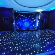 cowdray house dining room black led dancefloor blue uplighting and stage with band setup