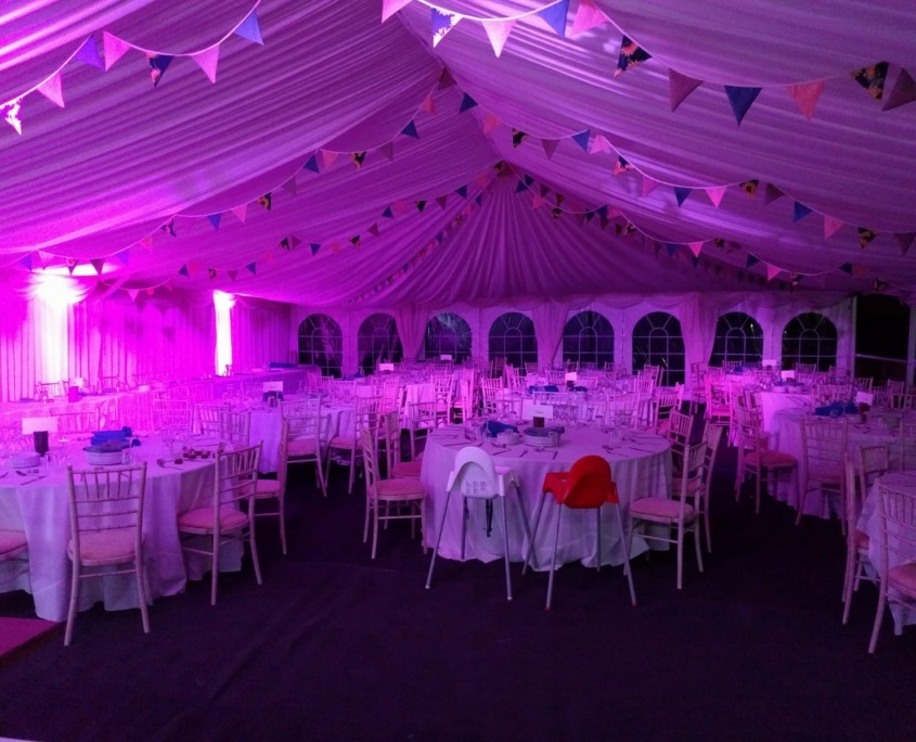 purple uplighters in marquee